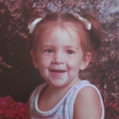 Childhood photo of BrandFuel employee Aarica Burkholder.