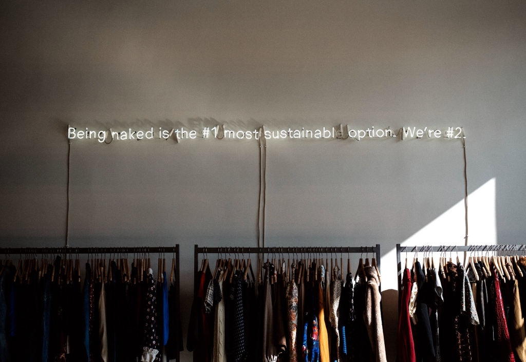 "Closet with text above it saying ""being naked is the most sustainable option."""