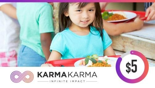 """A little girl with a plate of food with the """"Karma Karma"""" logo."""
