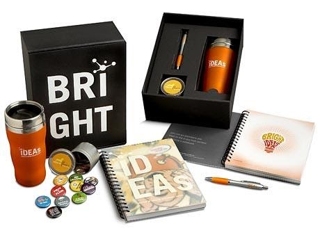 A variety of Bright Ideas merch including a notebook, planner, cup and coins.