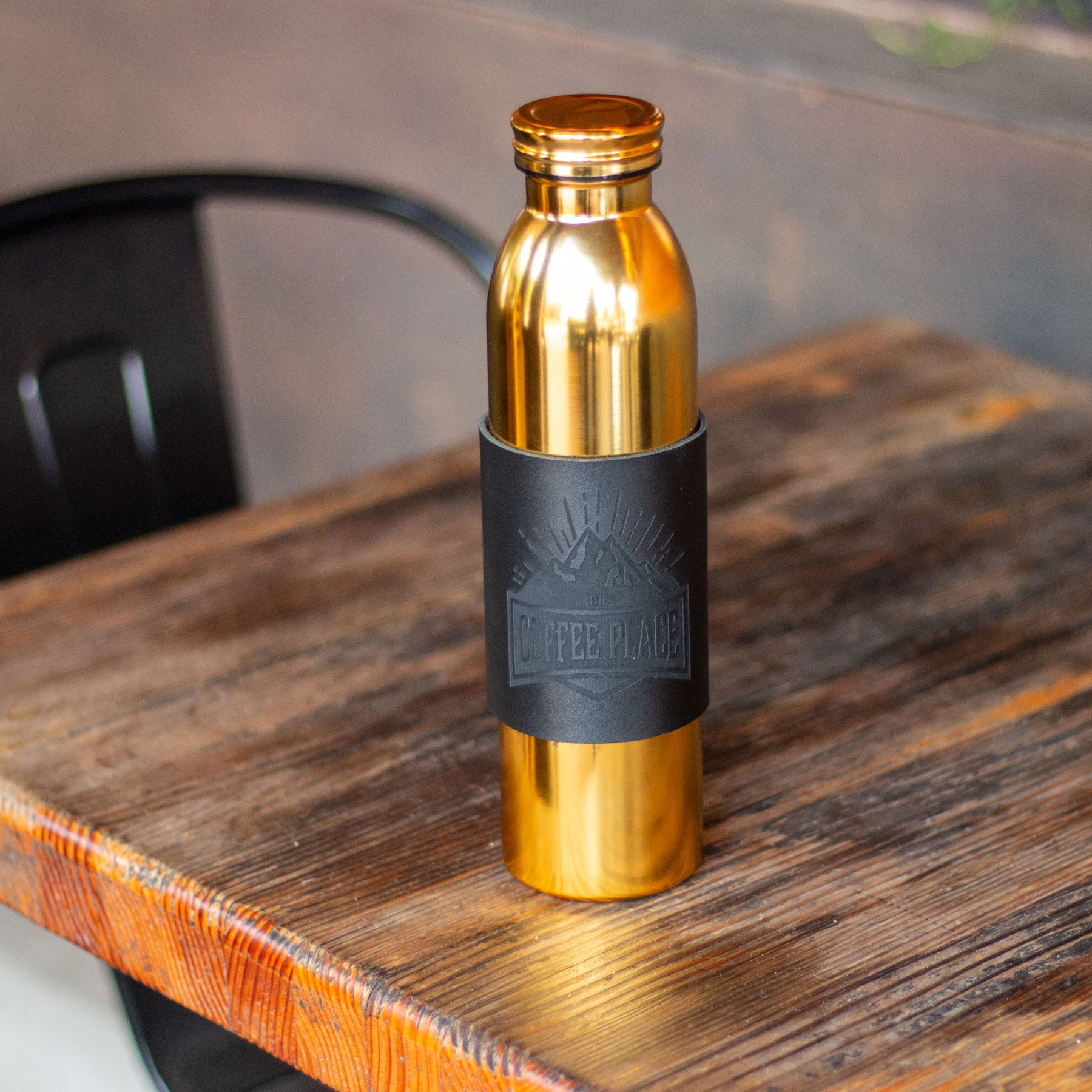 A gold reusable water bottle.
