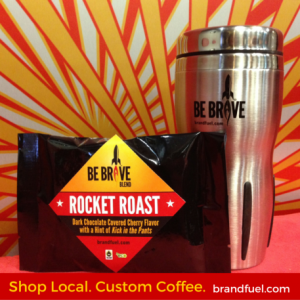 Branded coffee grounds and cup.