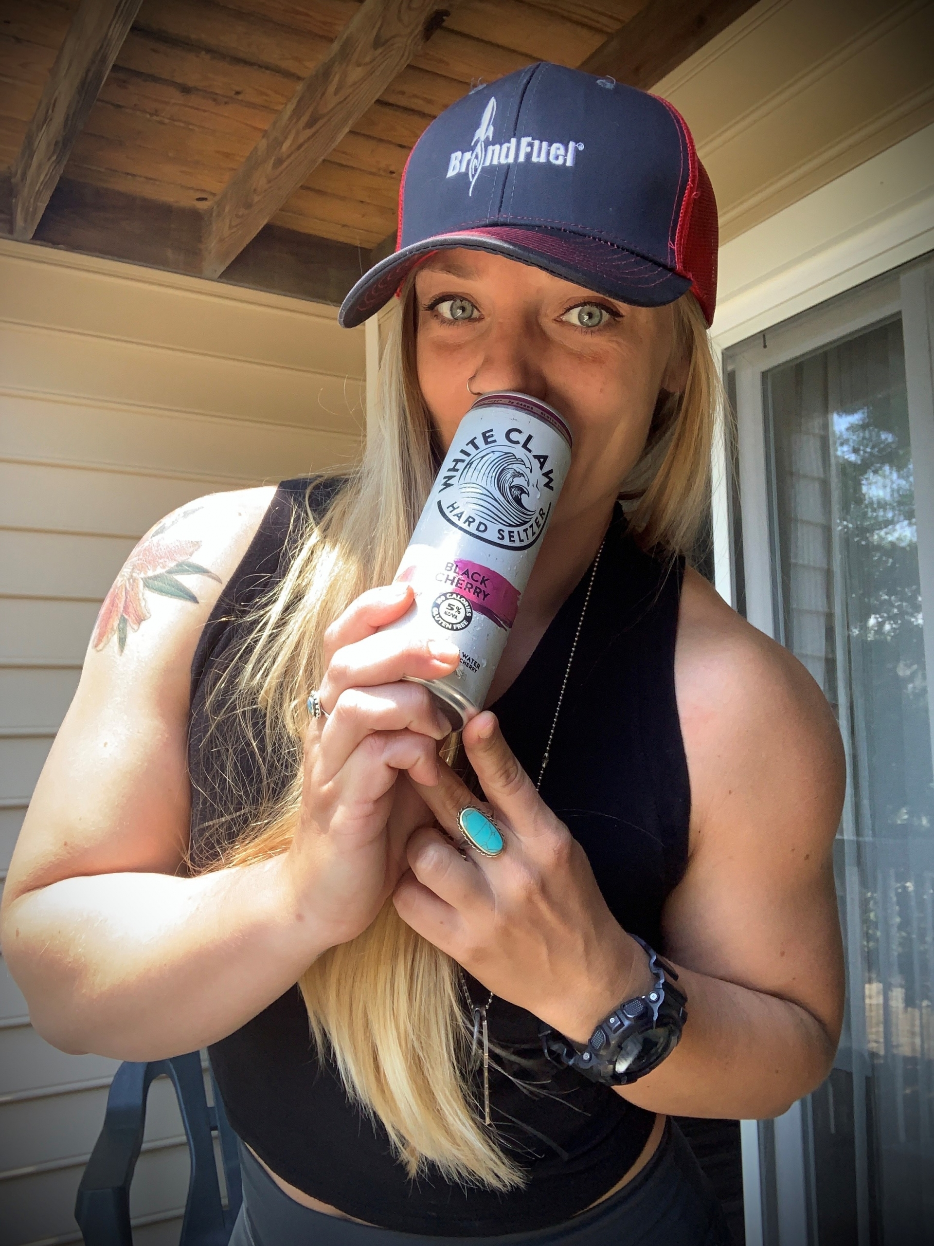 BrandFuel employee Annette Trayer holding a White Claw Hard Seltzer