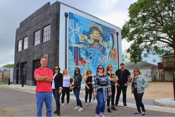 BrandFuel's Virginia team standing in front of their new office