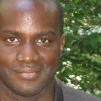 Headshot of Tola Oguntoyinb