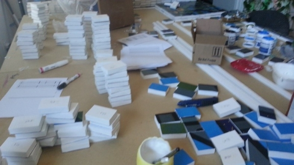 A stack of designed and blank blocks getting ready to be sent to clients.