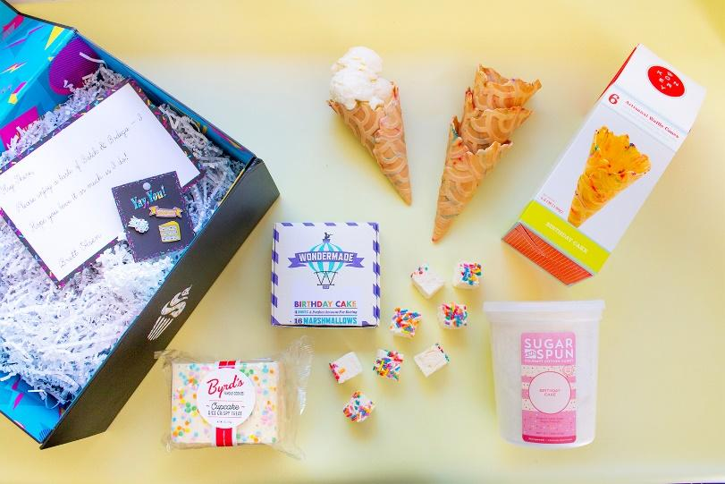 A gift box with ice cream cones and candy.