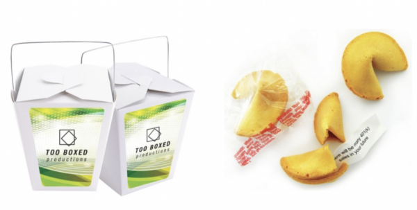 Chinese takeout-style boxes with fortune cookies and custom messages printed inside.