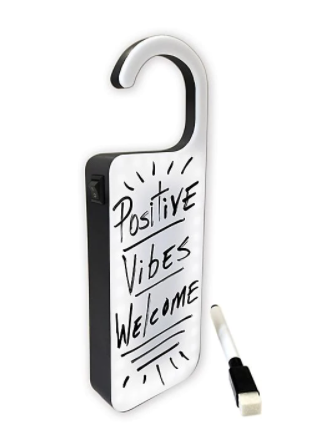 Doorknob hanger made out of a whiteboard that has Positive Vibes Only written on it in black marker.