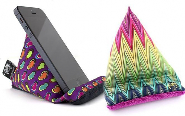 Geometric designs printed on pyramid-shaped squishy cell phone holders.